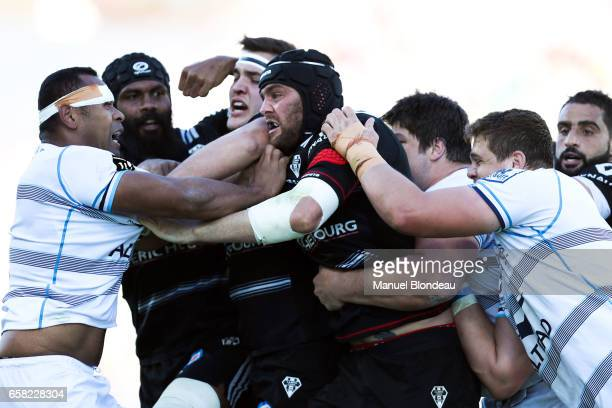 Johan Snyman of Brive and Akupusi Qera of Montpellier scuffle during the Top 14 match between Brive and Montpellier on March 26 2017 in Brive France
