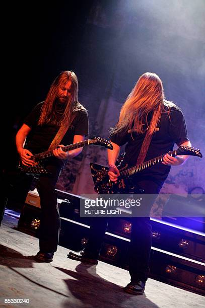Johan Soderberg and Olavi Mikkonen of Amon Amarth perform on stage at the HMV Forum