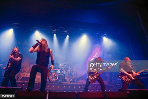 Johan Soderberg Johan Hegg Ted Lundstrom and Olavi Mikkonen of Amon Amarth perform on stage at Wulfrun Hall on October 28 2009 in Wolverhampton...