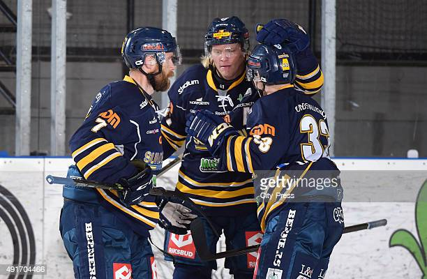 Johan Svedberg, Mathias Mansson and Tommy Stenqvist of IF Sundsvall Hockey celebrate after scoring the 1:0 during the game between IF Sundsvall...