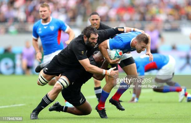 Johan Tromp of Namibia is tackled by Sam Whitelock of England during the Rugby World Cup 2019 Group B game between New Zealand and Namibia at Tokyo...