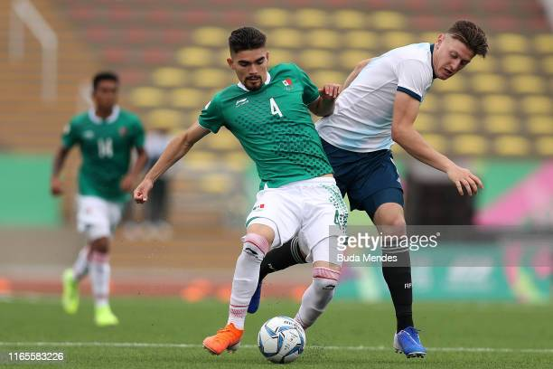 Johan Vasquez Ibarra of Mexico competes for the ball with Adolfo Gaich of Argentina during Men´s football First Round Group A match between Mexico...