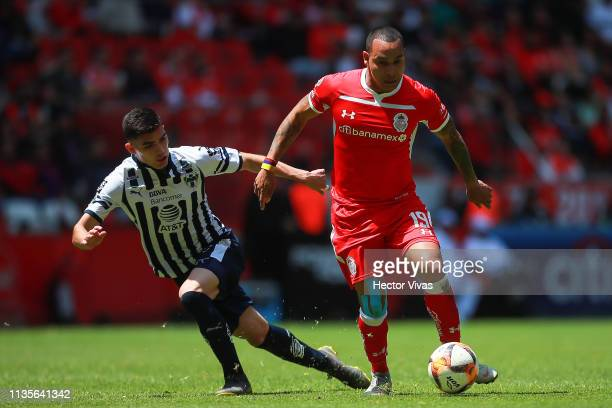Johan Vasquez of Monterrey struggles for the ball with Edgar Pardo of Toluca during the 13th round match between Toluca and Monterrey as part of the...