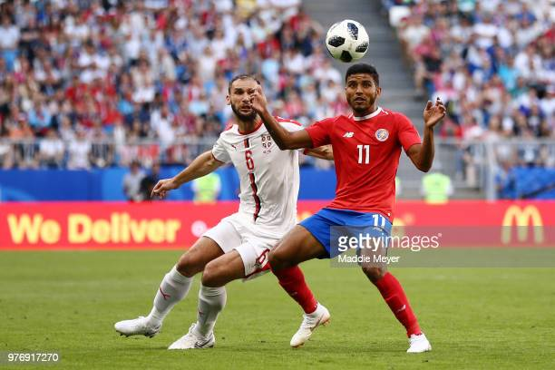 Johan Venegas of Costa Rica controls the ball under pressure from Branislav Ivanovic of Serbia during the 2018 FIFA World Cup Russia group E match...