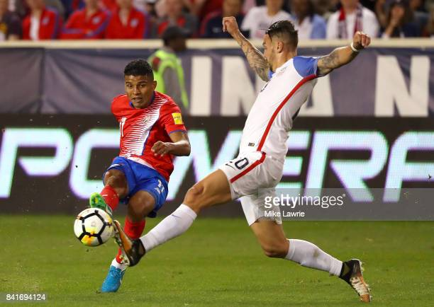 Johan Venegas of Costa Rica shoots against Geoff Cameron of the United States in the second half during the FIFA 2018 World Cup Qualifier at Red Bull...
