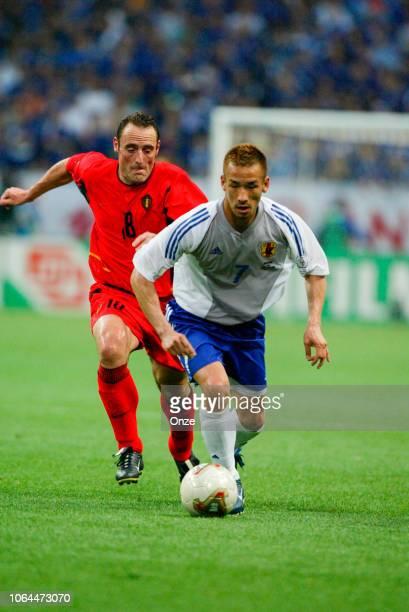 Johan Walem of Belgium and Hidetoshi Nakata of Japan during the World Cup match between Japan and Belgium in Saitama Stadium in Saitama Japan on June...