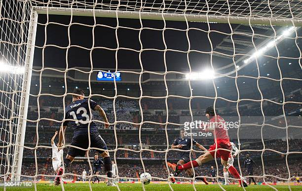 Johan Wiland and Yoshimar Yotun of Malmo FF fail to stop Karim Benzema of Real Madrid scoring Real's opening goal during the UEFA Champions League...