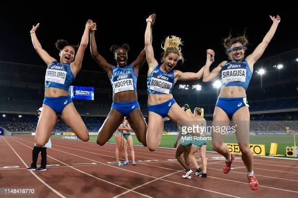 Johanelis Herrera Abreu Gloria Hooper Anna Bonggiorni and Irene Siragusa of Italy celebrate during round 1 of the Women's 4x100m Relay on day one of...