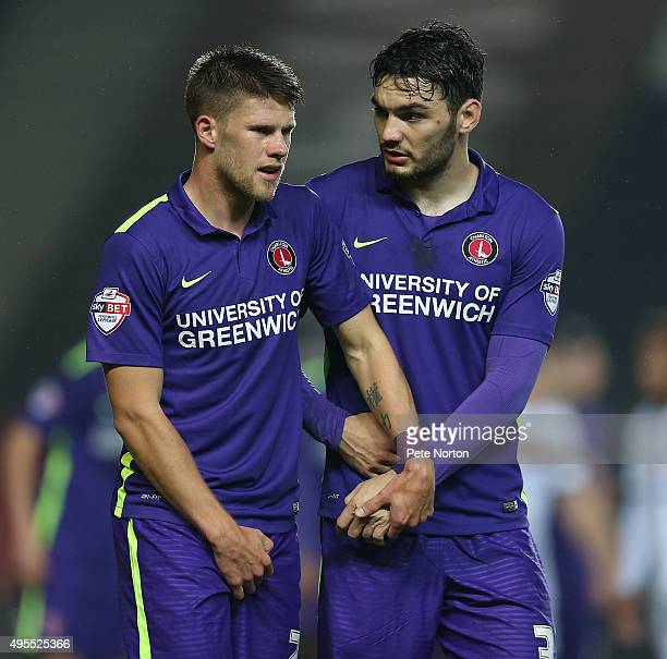 Johann Berg Gudmundsson and Tony Watt of Charlton Athletic line up to defend a free kick during the Sky Bet Championship match between Milton Keynes...
