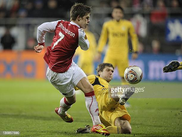 Johann Berg Gudmundsson of AZ,Oleg Shelayev of Metalist Kharkiv during the UEFA Europa League match between AZ Alkmaar and Metalist Kharkiv at the...