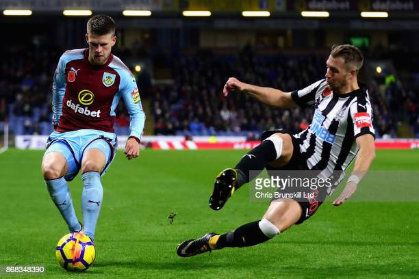 Johann Berg Gudmundsson of Burnley and Florian Lejeune of Newcastle United in action during the Premier League match between Burnley and Newcastle...