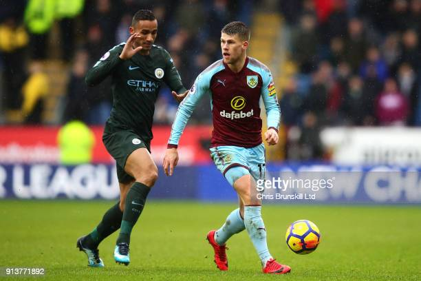 Johann Berg Gudmundsson of Burnley in action with Danilo of Manchester City during the Premier League match between Burnley and Manchester City at...