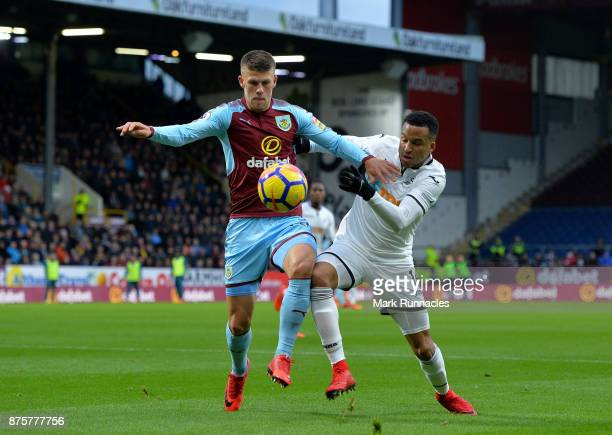 Johann Berg Gudmundsson of Burnley is tackled by Martin Olsson of Swansea City during the Premier League match between Burnley and Swansea City at...
