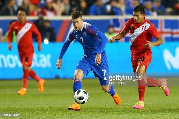 Johann Berg Gudmundsson of Iceland carries the ball against Renato Tapia of Peru during an International Friendly at Red Bull Arena on March 27 2018...