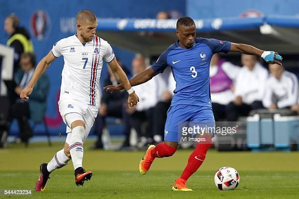 Johann Berg Gudmundsson of Iceland Patrice Evra of France during the UEFA EURO 2016 quarter final match between France and Iceland on July 3 2016 at...
