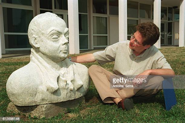 Johann Bihr poses at home in Mantes la Jolie beside a bust of Saint Exupery JBihr is the youngest secondary school student to have won a prize in the...