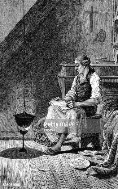 Johann Friedrich Oberlin Lutheran philanthropist and pastor in Vosges region of France cooking a frugal meal and reading Photo12/UIG via Getty Images