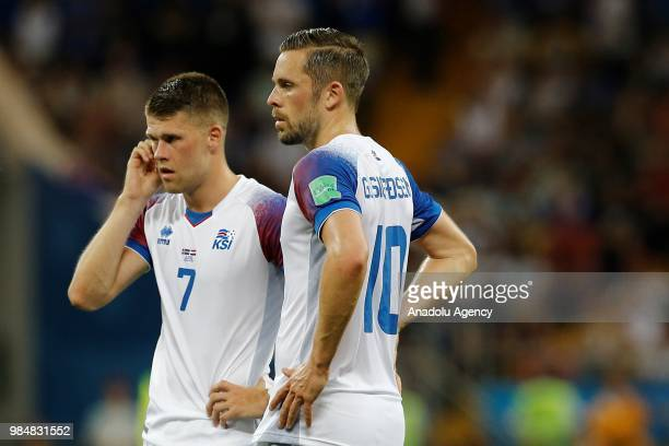 Johann Gudmundsson and Gylfi Sigurdsson of Iceland are seen during the 2018 FIFA World Cup Russia Group D match between Iceland and Croatia at the...