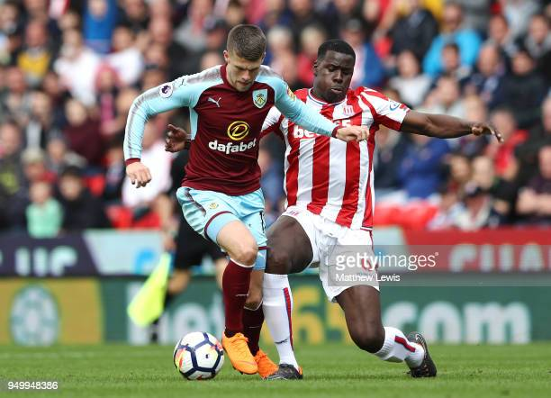 Johann Gudmundsson of Burnley and Kurt Zouma of Stoke City in action during the Premier League match between Stoke City and Burnley at Bet365 Stadium...