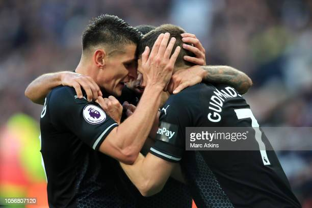 Johann Gudmundsson of Burnley celebrates with his teammates after he scores his sides first goal during the Premier League match between West Ham...