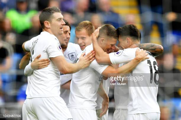 Johann Gudmundsson of Burnley celebrates with team mates after scoring his team's first goal during the Premier League match between Cardiff City and...