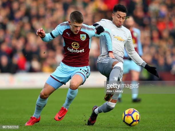 Johann Gudmundsson of Burnley is challenged by Jesse Lingard of Manchester United during the Premier League match between Burnley and Manchester...