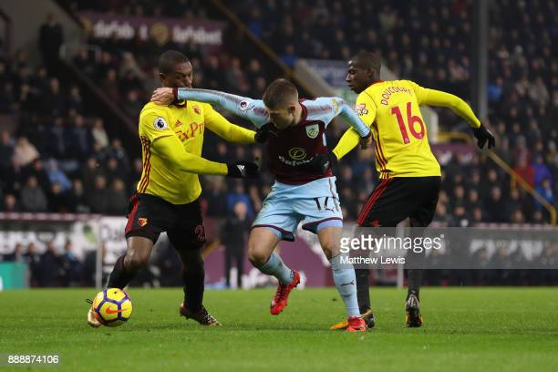 Johann Gudmundsson of Burnley makes his way past Abdoulaye Doucoure of Watford during the Premier League match between Burnley and Watford at Turf...