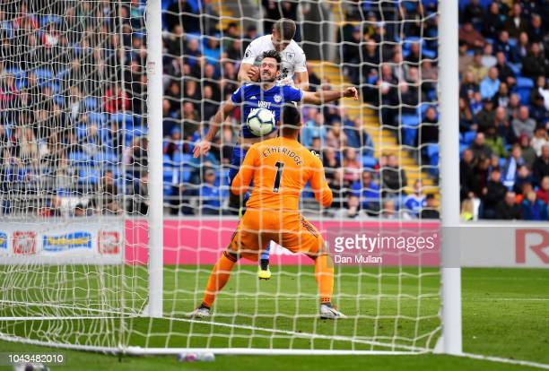 Johann Gudmundsson of Burnley scores his team's first goal during the Premier League match between Cardiff City and Burnley FC at Cardiff City...