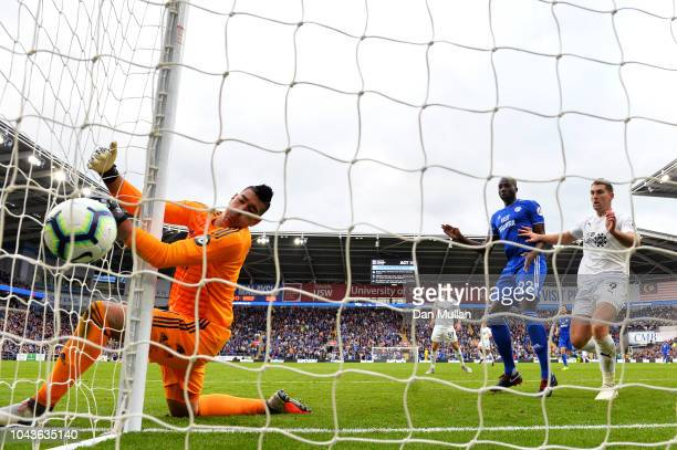 Johann Gudmundsson of Burnley scores his team's first goal past Neil Etheridge of Cardiff City during the Premier League match between Cardiff City...
