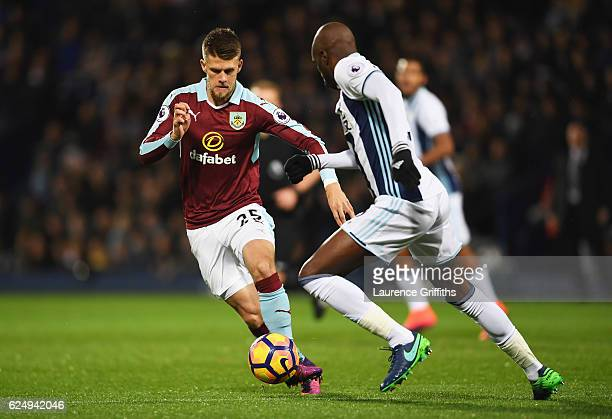 Johann Gudmundsson of Burnley takes on AllanRomero Nyom of West Bromwich Albion during the Premier League match between West Bromwich Albion and...