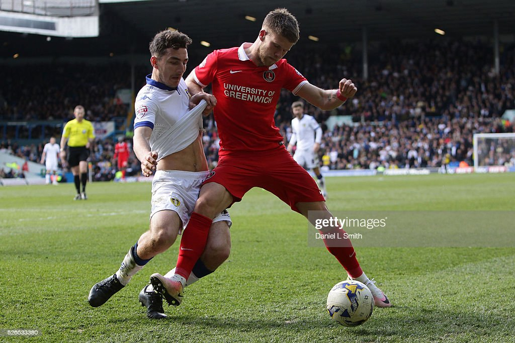 Johann Gudmundsson of Charlton Athletic FC holds off Lewie Coyle of Leeds United FC during the Sky Bet Championship match between Leeds United and Charlton Athletic at Elland Road on April 30, 2016 in Leeds, United Kingdom.