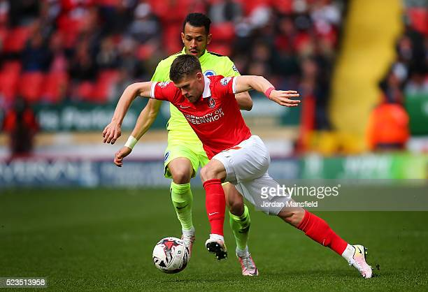 Johann Gudmundsson of Charlton takes the ball past Liam Rosenior of Brighton Hove Albion during the Sky Bet Championship match between Charlton...