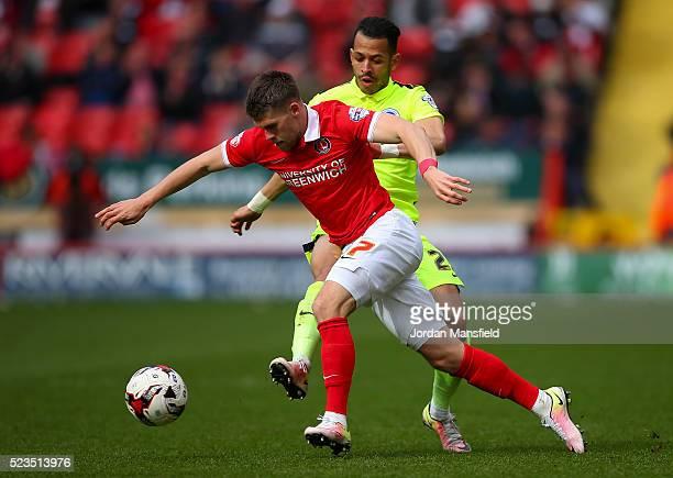 Johann Gudmundsson of Charlton takes the ball past Liam Rosenior of Brighton & Hove Albion during the Sky Bet Championship match between Charlton...