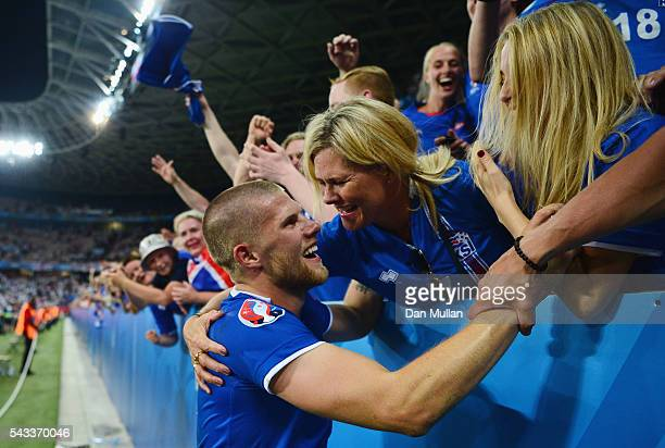 Johann Gudmundsson of Iceland celebrates his team's 21 win with his family after the UEFA EURO 2016 round of 16 match between England and Iceland at...