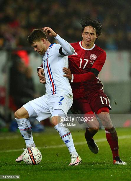 Johann Gudmundsson of Iceland holds off Thomas Delaney of Denmark during the International Friendly match between Denmark and Iceland at the MCH...