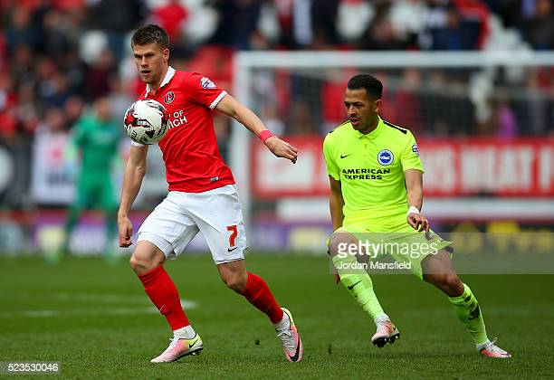 Johann Gumundsson of Charlton controls the ball under pressure from Liam Rosenior of Brighton & Hove Albion during the Sky Bet Championship match...