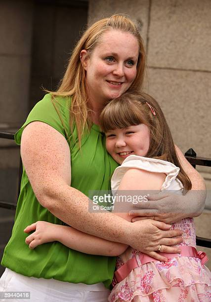 Johann Harrison embraces her daughter India Harrison age 9 outside the Law Society following a ruling that Corby Council have been found to be...