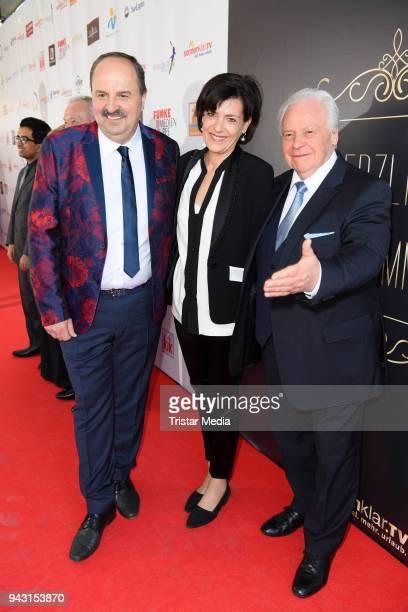 Johann Lafer and Eckart Witzigmann with his girlfriend Nicola Schnelldorfer attend the 'Goldene Sonne 2018' Award by SonnenklarTV on April 7 2018 in...