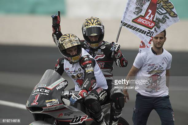 Johann Zarco of France and Ajo Motorsport celebrates the victory with the flag and become the 2016 Moto2 Champion at the end of the Moto2 race during...