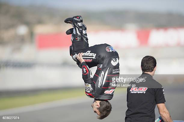 Johann Zarco of France and Ajo Motorsport jumps at the end of the 2016 three world champions photo opportunity on track at the end of the MotoGP race...