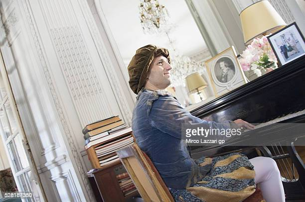 Johann Zarco of France and Ajo Motorsport plays the piano during a preview event at the Chateau du Lude ahead of the MotoGp of France on May 4 2016...