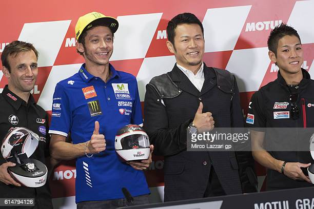 Johann Zarco of France and Ajo Motorsport Valentino Rossi of Italy and Movistar Yamaha MotoGP and Hiroki Ono of Japan and Honda team Asia pose during...