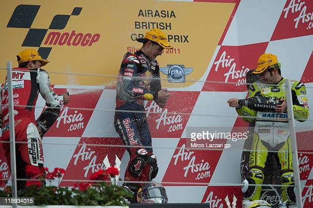 Johann Zarco of France and Avant Air Asia Ajo Jonas Folger of Germany and Red Bull Ajo Motorsport and Hector Faubel of Spain and Aspar Team celebrate...