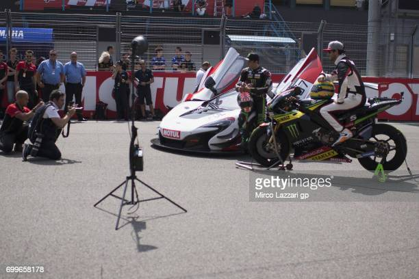 Johann Zarco of France and Monster Yamaha Tech 3 and Bruno Senna of Brasile pose with the bike and the car during the preevent A race between a...