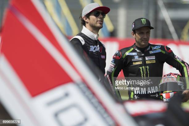 Johann Zarco of France and Monster Yamaha Tech 3 and Bruno Senna of Brasile pose during the preevent A race between a Yamaha M1 and a McLaren GT3...