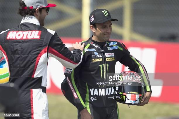 Johann Zarco of France and Monster Yamaha Tech 3 and Bruno Senna of Brasile joke during the preevent A race between a Yamaha M1 and a McLaren GT3...