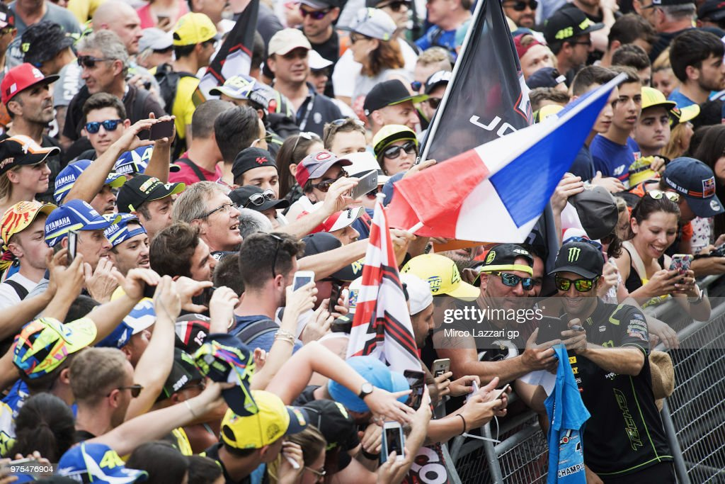 Johann Zarco of France and Monster Yamaha Tech 3 poses for fans in pit during the pit walk during the MotoGp of Catalunya - Free Practice at Circuit de Catalunya on June 15, 2018 in Montmelo, Spain.