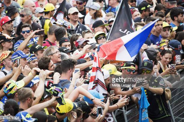 Johann Zarco of France and Monster Yamaha Tech 3 poses for fans in pit during the pit walk during the MotoGp of Catalunya Free Practice at Circuit de...