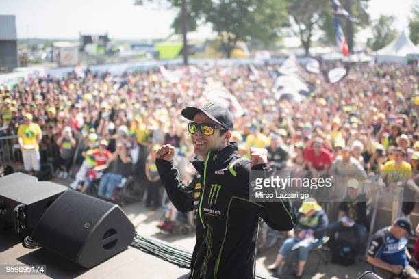 Johann Zarco of France and Monster Yamaha Tech 3 poses for fans during the autographs session during the MotoGp of France Free Practice on May 18...