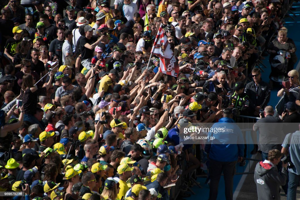 Johann Zarco of France and Monster Yamaha Tech 3 signs autographs for fans in pit during the MotoGp of France - Previews on May 17, 2018 in Le Mans, France.